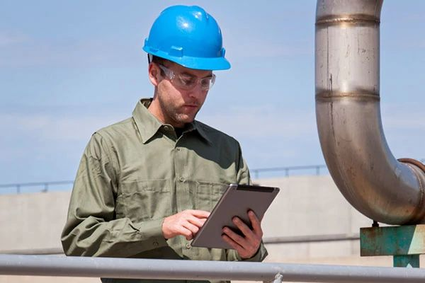 Facility Manager Monitoring Water Waste